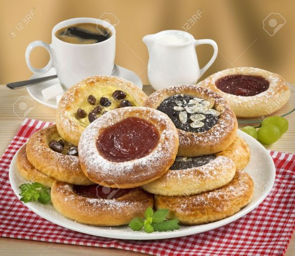 5030603-moravian-poppyseed-curd-and-jam-cakes-and-a-cup-of-coffee-stock-photo