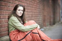 vulnerable-teenage-girl-sleeping-street-portrait-72066364