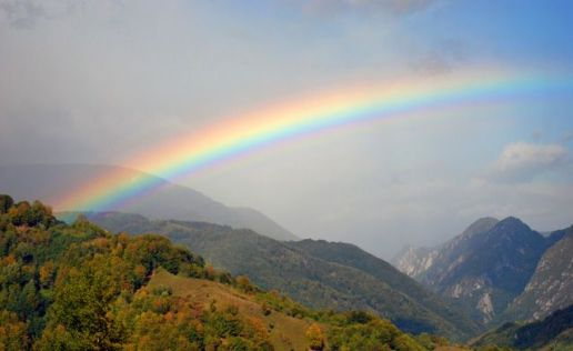 rainbow-stretching-hilly-forest-mountains-638x0_q80_crop-smart
